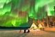 Dazzling displays of aurora borealis dance across the night sky